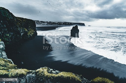 istock Sunrise at famous Black Sand Beach Reynisfjara in Iceland. Windy Morning. Ocean Waves. Colorful Sky. Morning Sunset 1010058776