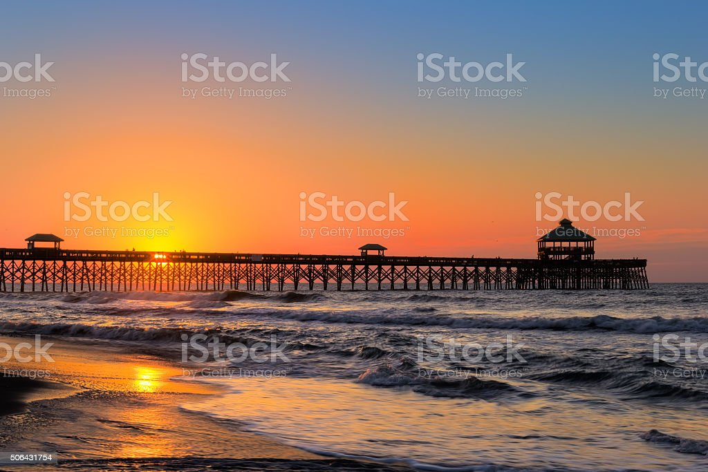 Sunrise at Folly stock photo