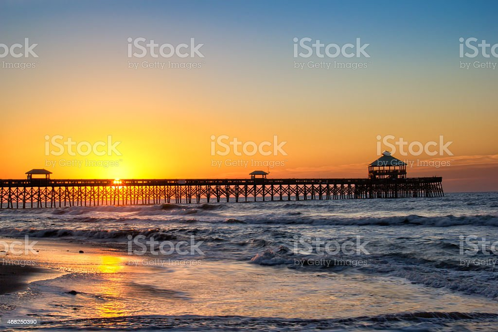 Sunrise at Folly Pier stock photo