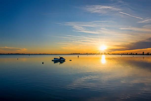 Sunrise at Lake Boga with a jet ski stock photo