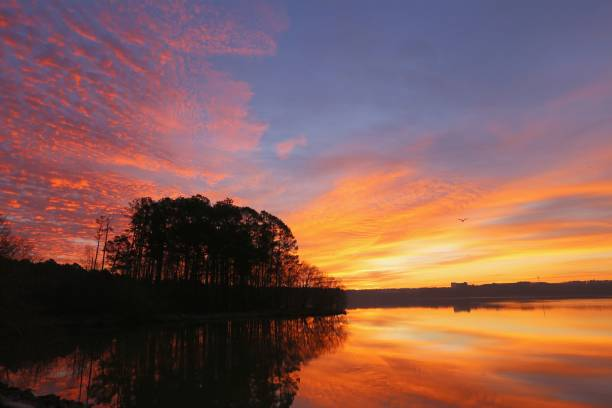 Sunrise at Lake Crabtree County Park stock photo