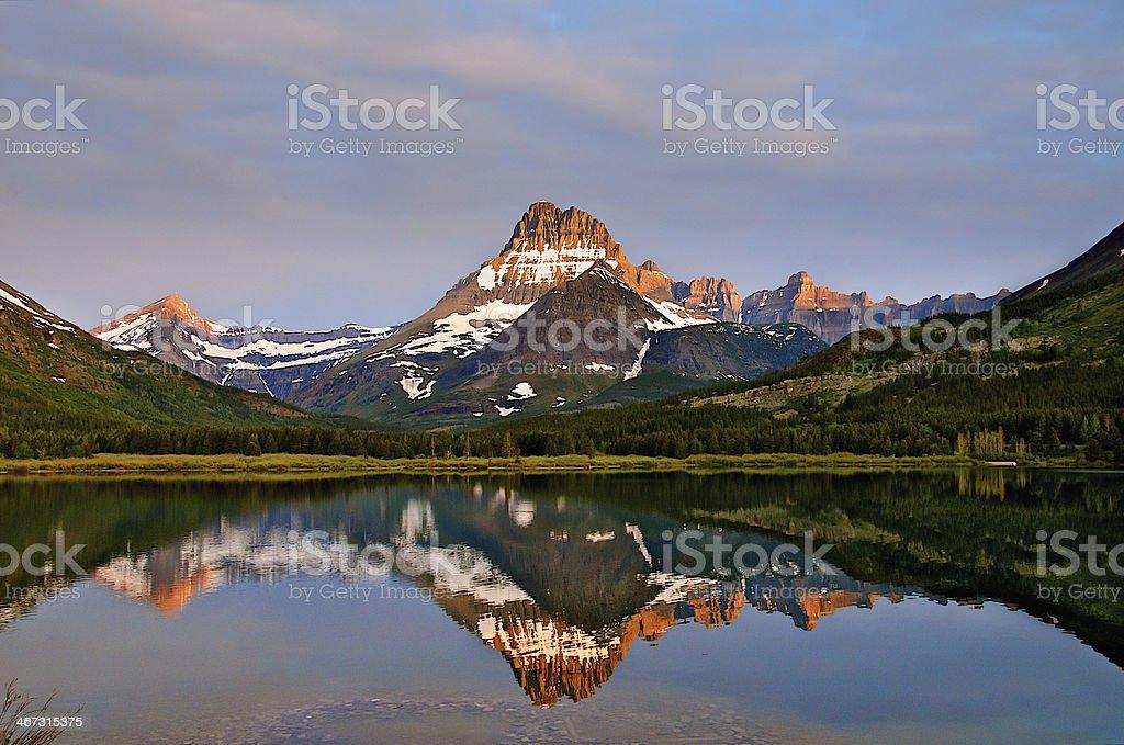 Sunrise at Many Glacier Lake royalty-free stock photo
