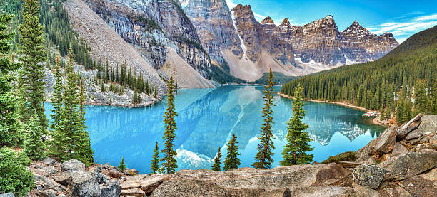 Sunrise at Moraine lake Moraine lake panorama in Banff National Park, Alberta, Canada valley of the ten peaks stock pictures, royalty-free photos & images