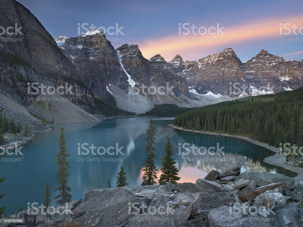 Sunrise at Moraine Lake with snow on mountains, Canadian Rockies stock photo