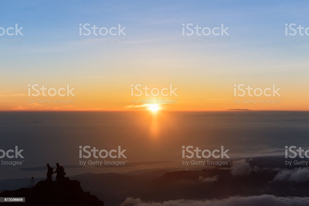 Sunrise at Mount Rinjani summit on morning. Lombok island, Indonesia. stock photo