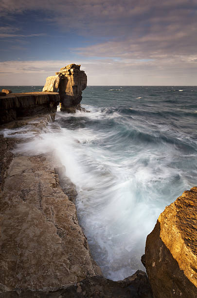 sunrise at pulpit rock - pulpit rock dorset stock photos and pictures