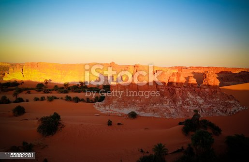 Sunrise at sandstone formation in the Sahara desert near Yoa Lake group of Ounianga Kebir in Ennedi, Chad