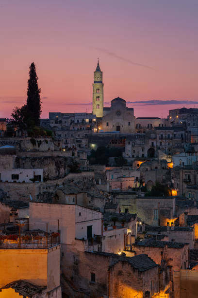 Sunrise at Sasso Barisano and in the background the cathedral Madonna della Bruna stock photo