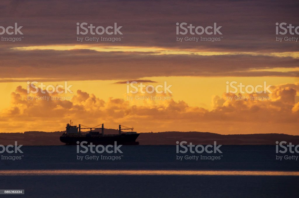 Sunrise at Sea with a tanker in the horisont stock photo