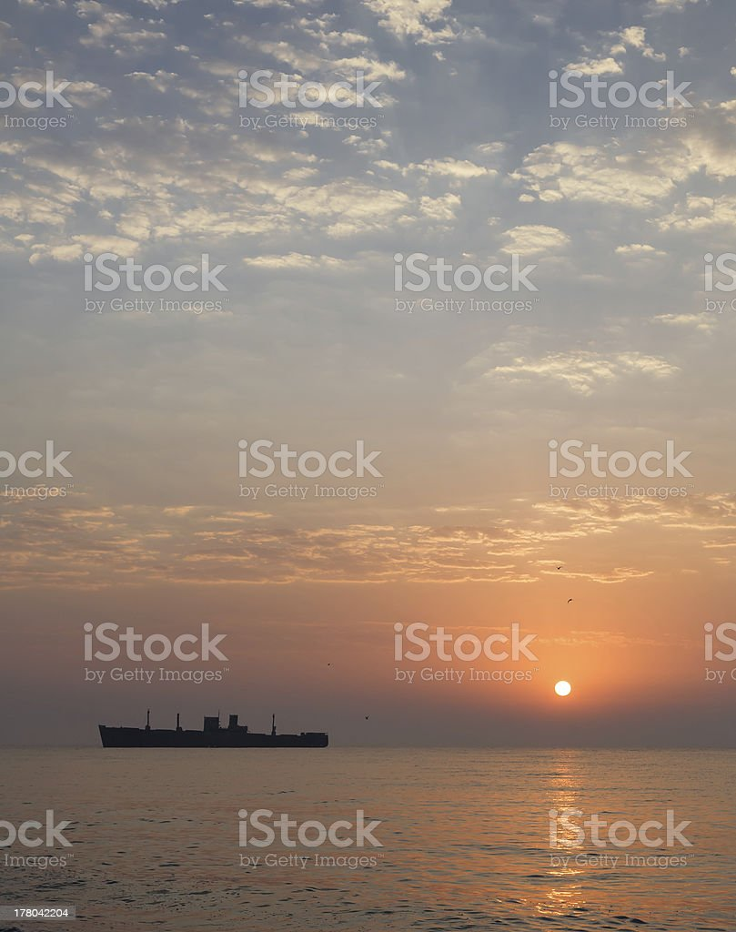 sunrise at seaside with a shipwreck royalty-free stock photo