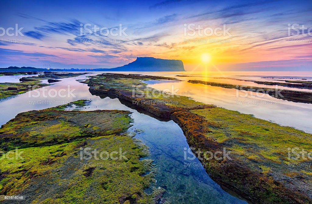Sunrise at Seongsan Ilchulbong, Jeju island, South Korea. stock photo