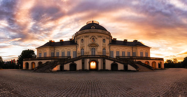 sunrise at solitude castle - schloss stuttgart stock-fotos und bilder