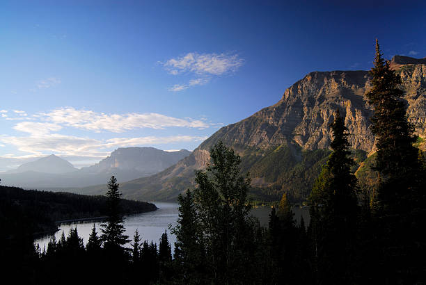 sunrise at st mary lake - st. mary lake stock pictures, royalty-free photos & images