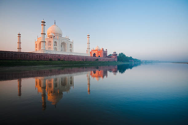 sunrise at taj mahal on jamuna river - india stock pictures, royalty-free photos & images