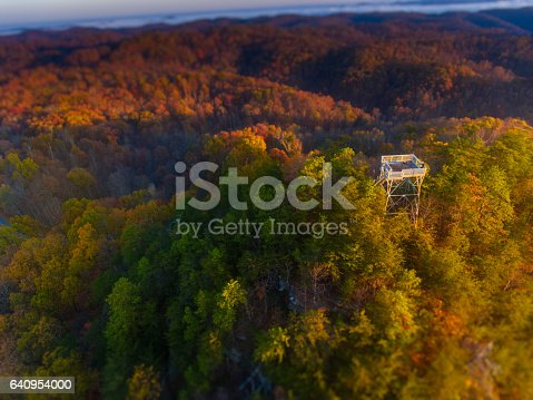 Sun rises over the wilderness of Appalachian mountains near the Tater Knob tire tower in the Daniel Boone National Forest.  Though unused for decades, the fire tower is still accessible to hikers and travelers who go off the beaten path.