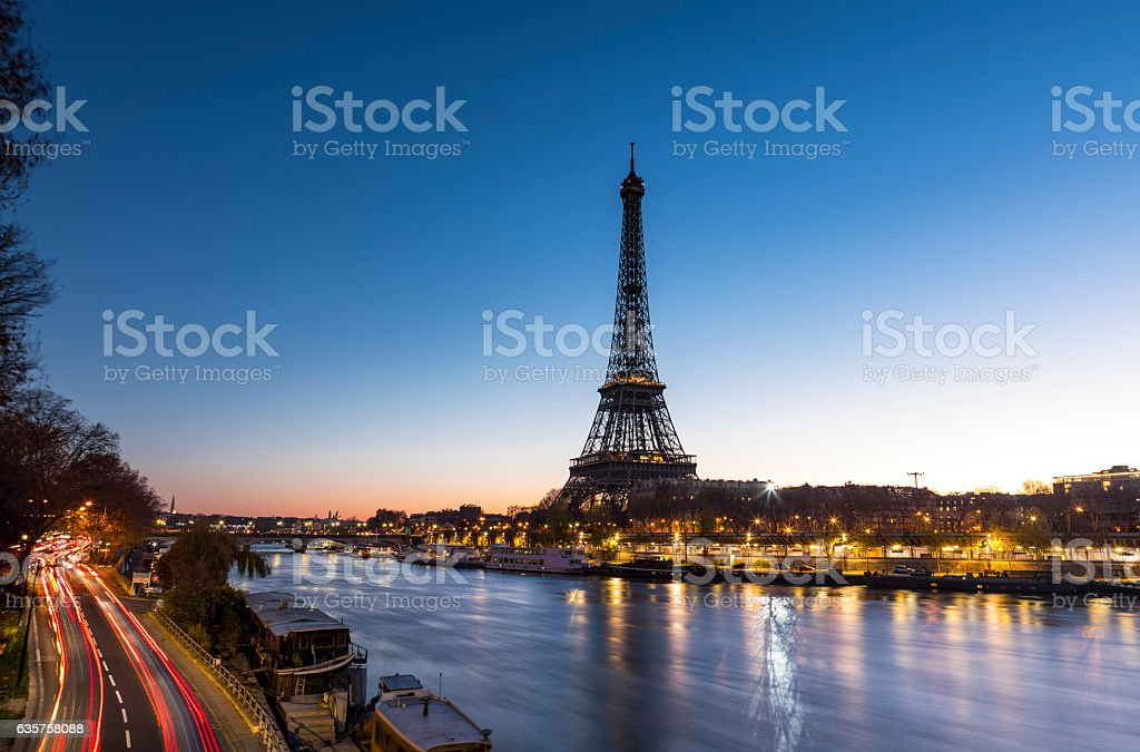 Sunrise at the Eiffel Tower in Paris along the Seine stock photo