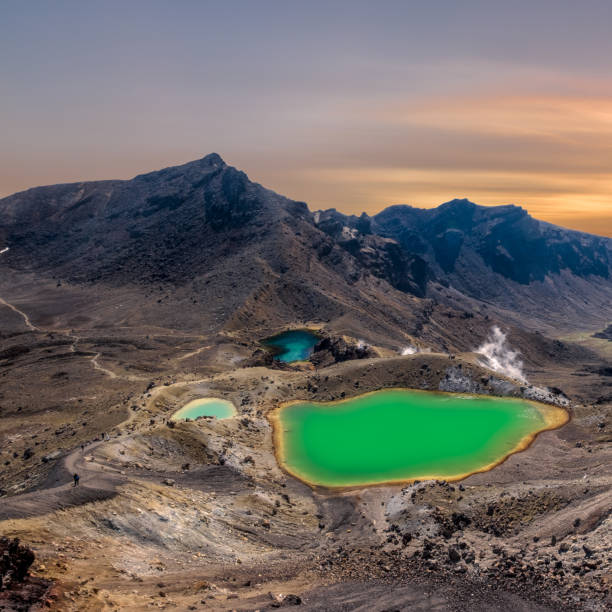 Sunrise at the Emerald Lakes at the popular Tongariro Alpine Crossing hike in New Zealand Sunrise at the Emerald Lakes at the popular Tongariro Alpine Crossing hike in New Zealand emerald lake stock pictures, royalty-free photos & images