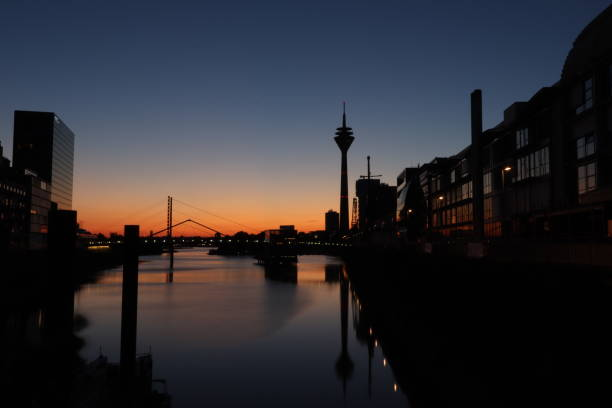 Sunrise at the harbour part of the city of Duesseldorf Panoramatic view to the Rhinetower, and the modern facade of the buildings in the harbour of Duesseldorf alias stock pictures, royalty-free photos & images