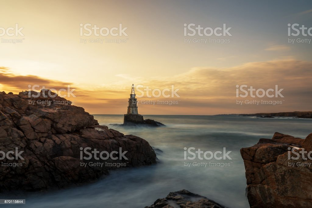 Sunrise at the lighthouse in Ahtopol, Bulgaria. stock photo