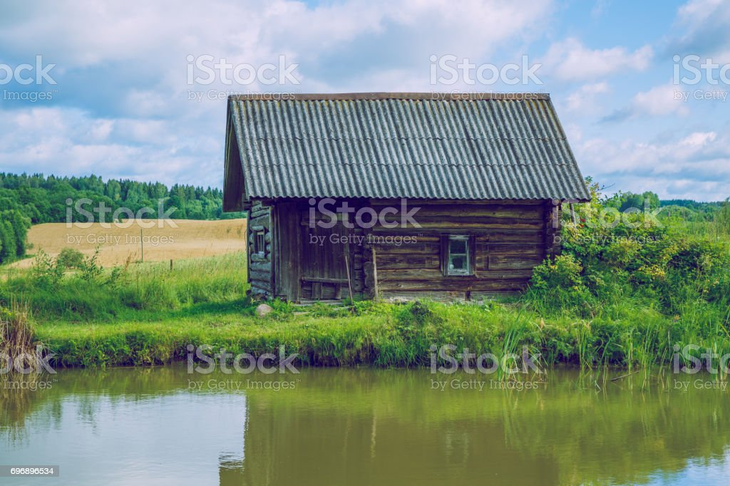 Sunrise at the pond with a view of the room and meadow. 2016 stock photo