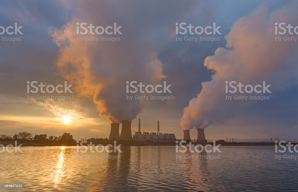 Sunrise at the power station stock photo