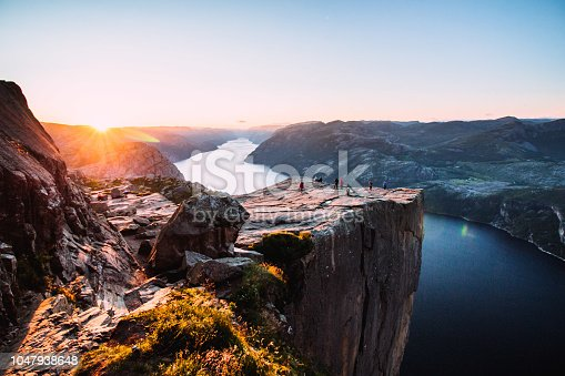 Warm orange sunrise at the Preikestolen in the summer in Norway
