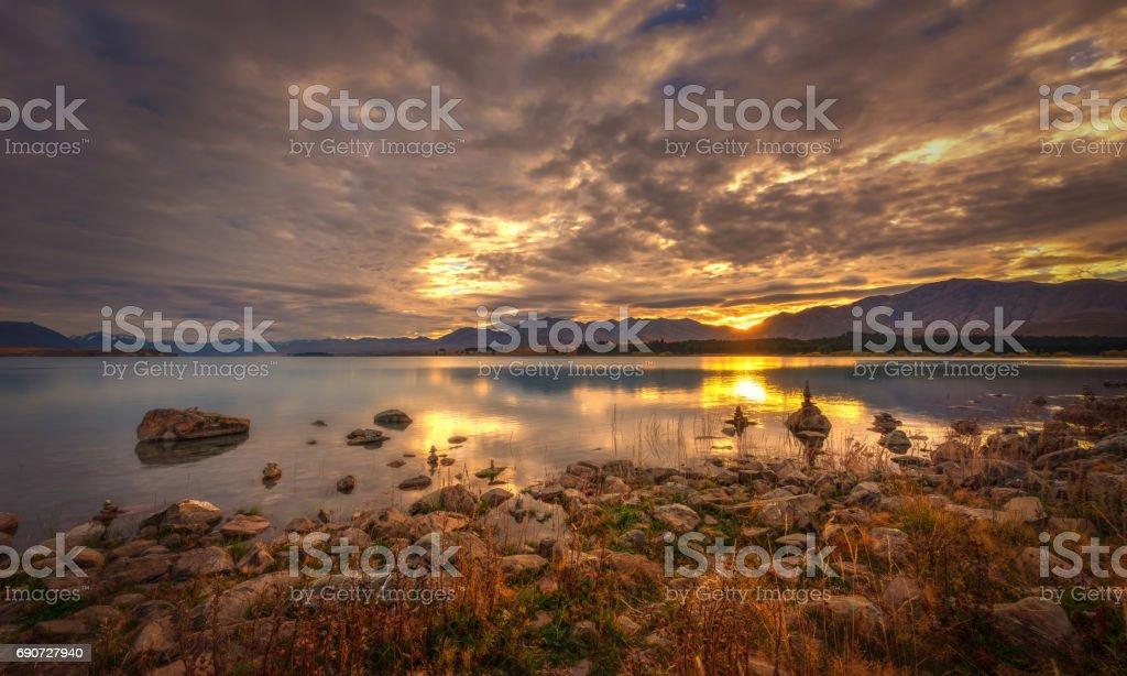 Sunrise At The Rocky Banks Of Lake Tekapo stock photo
