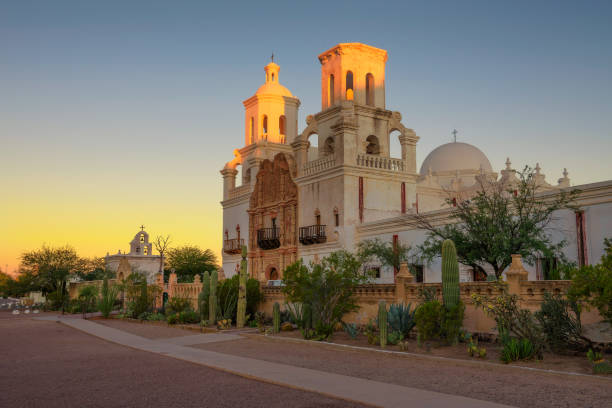Sunrise at the San Xavier Mission Church in Tucson Sunrise at the San Xavier Mission Church in Tucson, Arizona. This historic spanish catholic mission was founded in 1692 and is located on the Tohono O'odham Nation indian reservation. tucson stock pictures, royalty-free photos & images