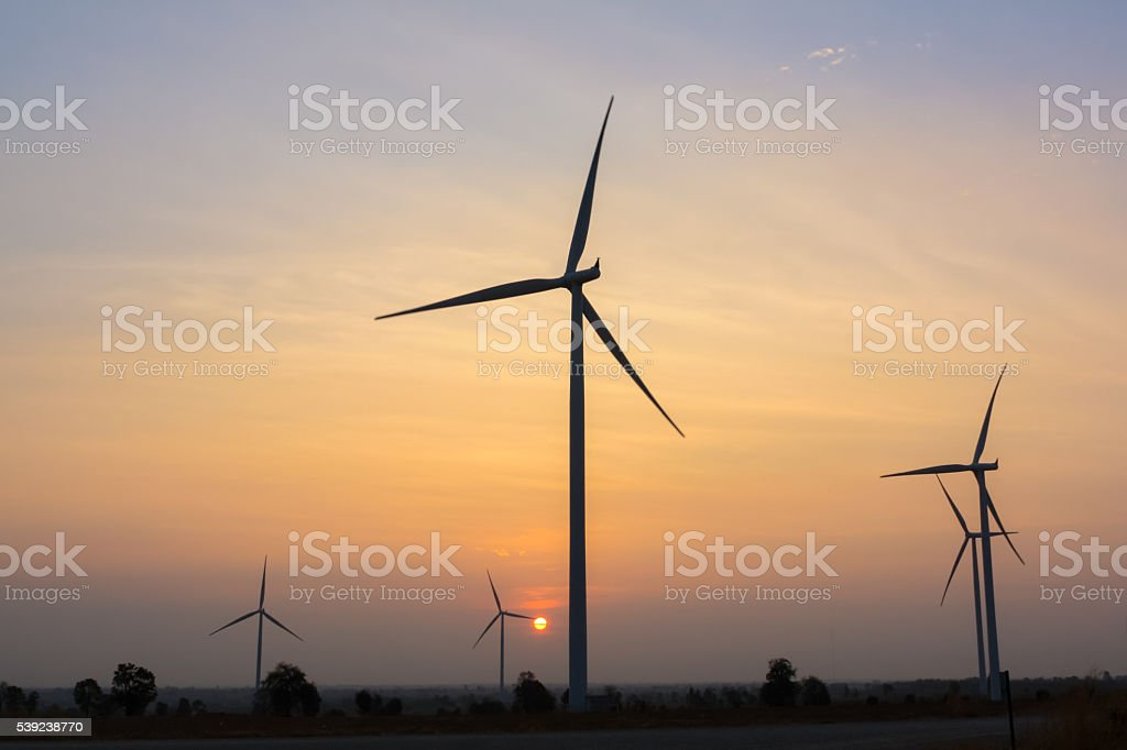 Sunrise at wind generator farm royalty-free stock photo