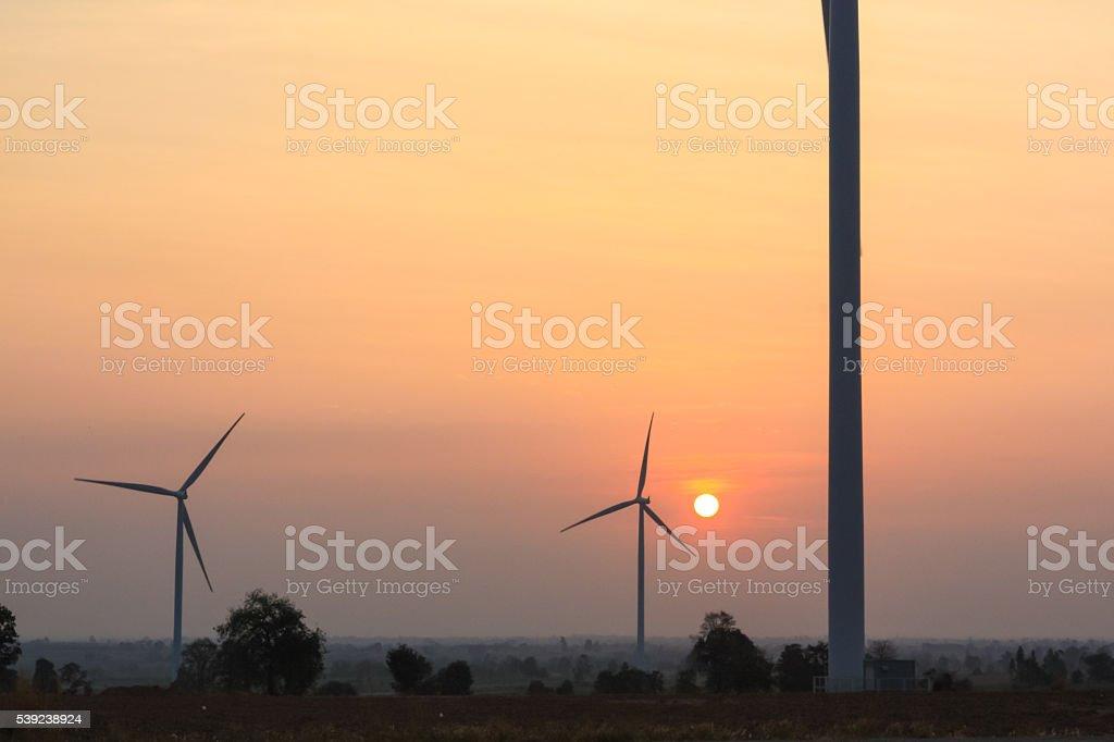 Sunrise at wind generator farm foto de stock libre de derechos