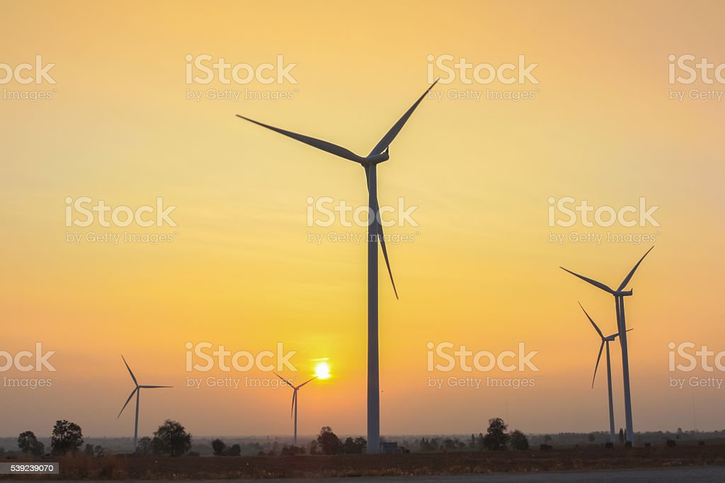 Sunrise at wind generator farm foto de stock libre de derechos