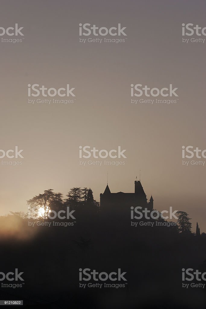 Sunrise behind a hilltop chateau in France stock photo