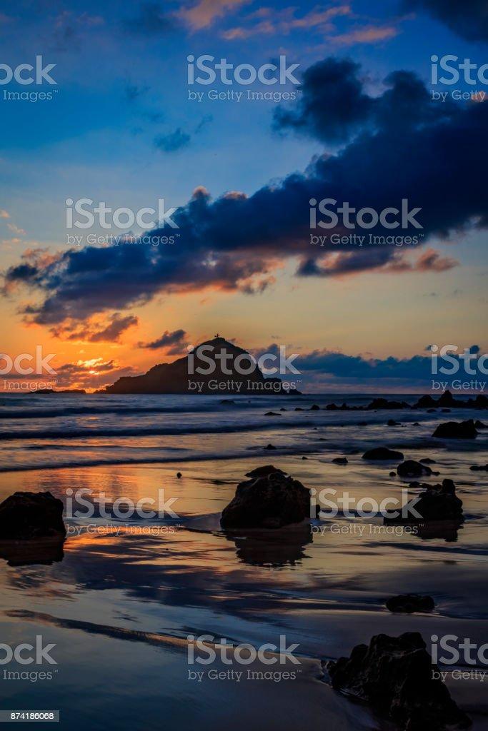 Sunrise behind Alau Island stock photo