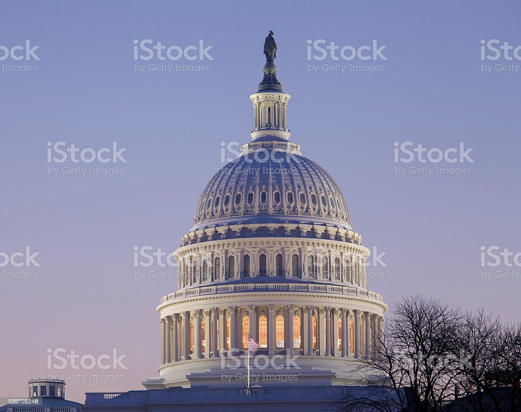 Sunrise behind the dome of Capitol in DC royalty-free stock photo