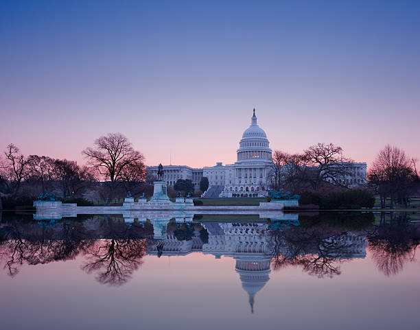 Sunrise behind the dome of Capitol in DC stock photo