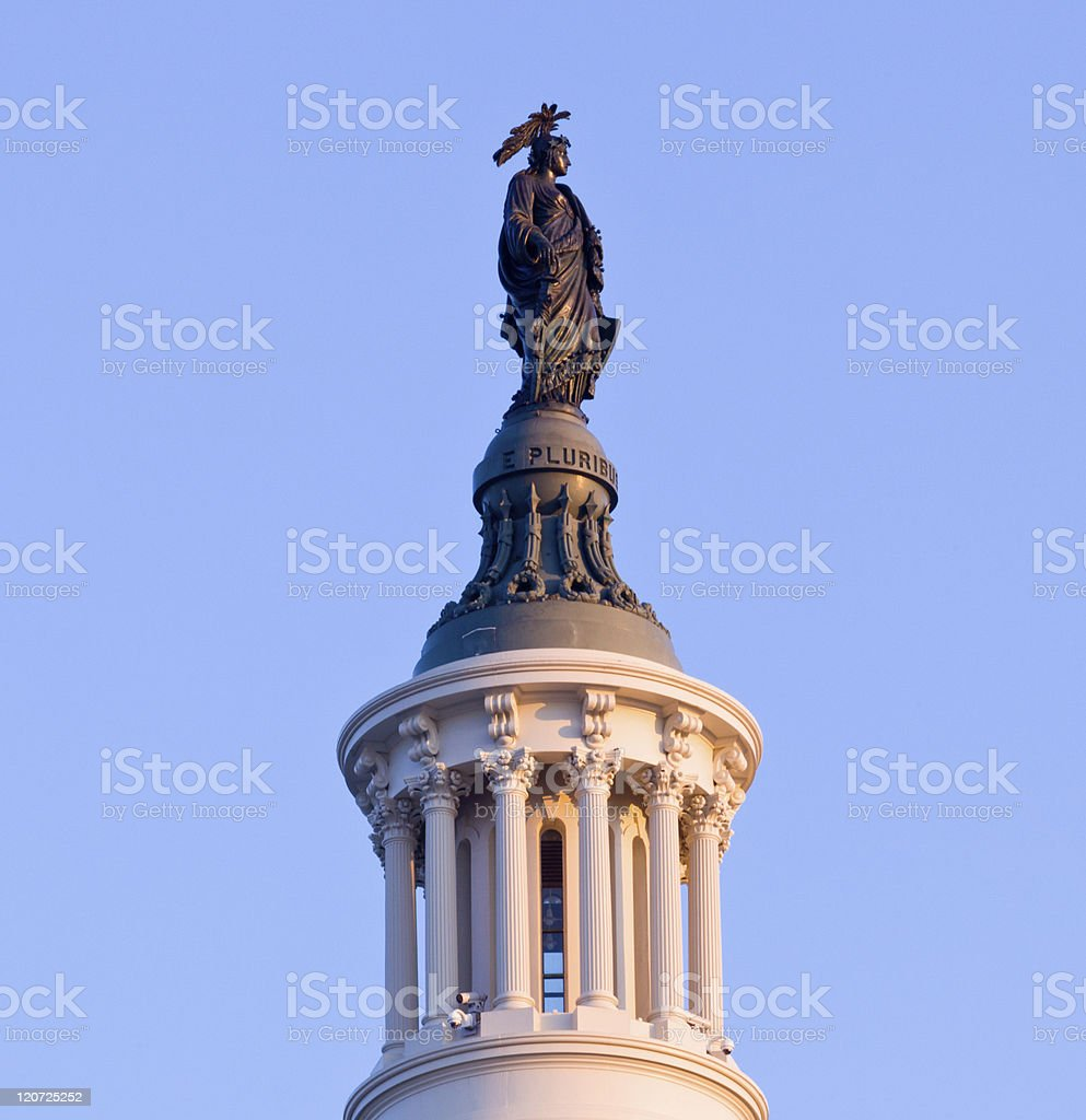 Sunrise behind the Statue of Freedom in DC stock photo