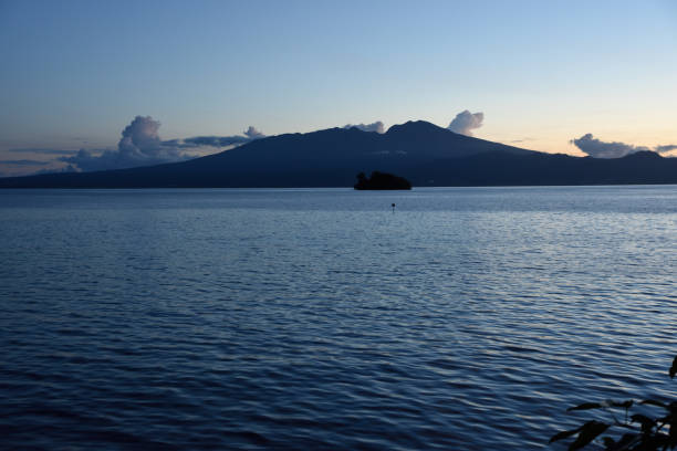 Sunrise behind the volcano on Kolombangara near Gizo, Western Province, Solomon Islands, South Pacific Ocean