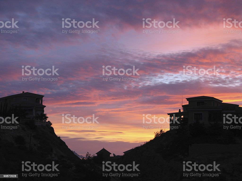 Sunrise between villas royalty-free stock photo