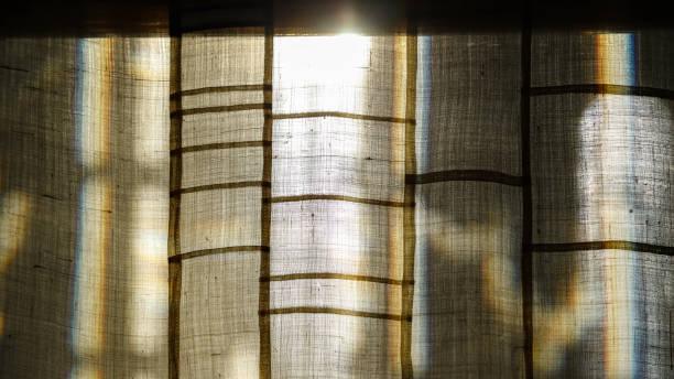 Sunrise beyond the curtains stock photo