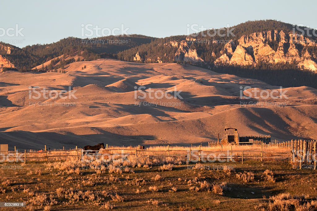 Sunrise Bighorn Mountains Fort Phil Kearney fence horse Wyoming stock photo