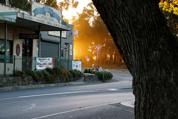 Sunrise Breaking Behind Small Country Shopping Centre stock photo