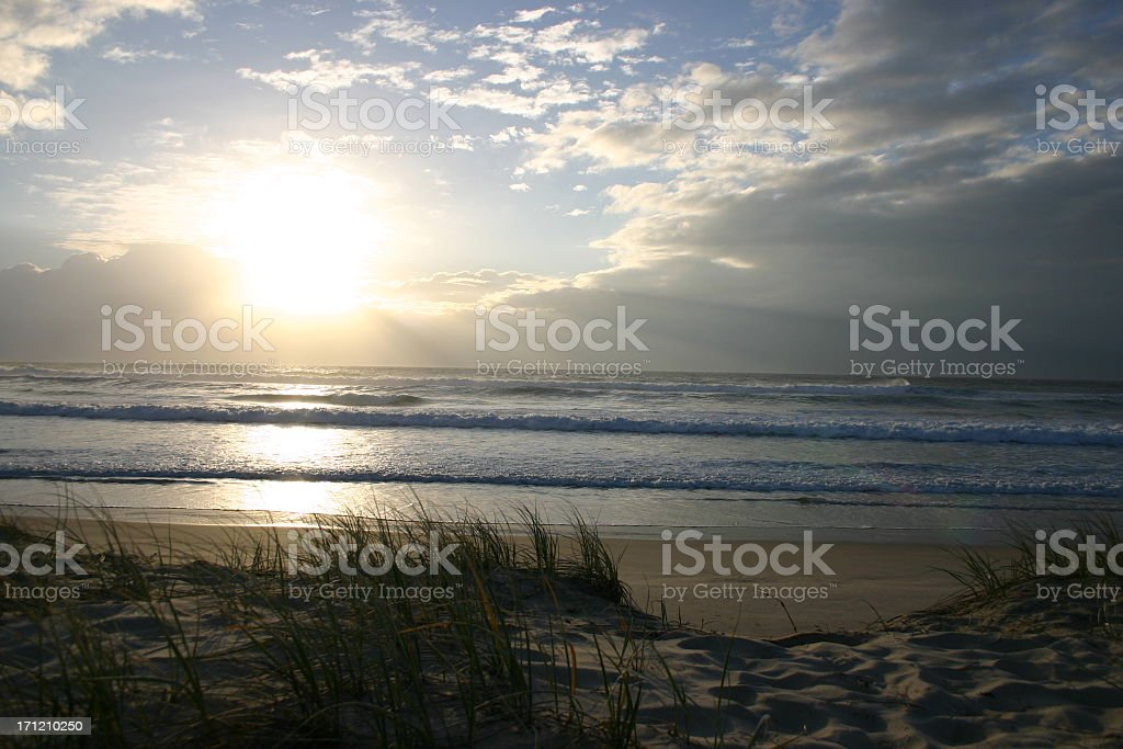 sunrise breaking through the clouds at beach royalty-free stock photo