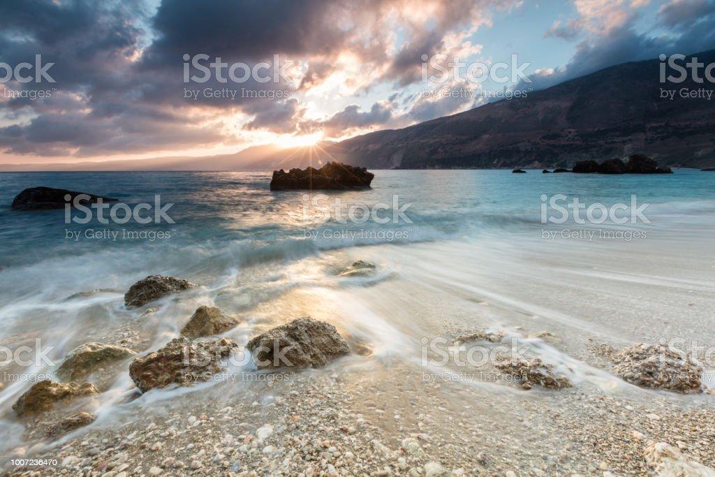 Sunrise by the sea of an Ioanian island stock photo