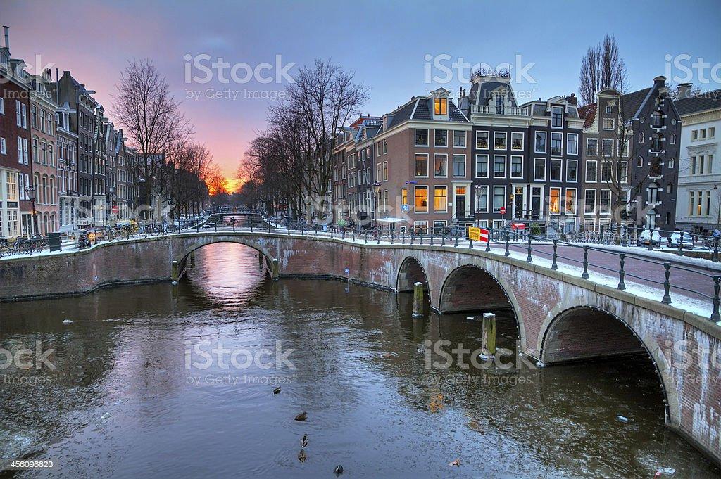 Sunrise canal winter Amsterdam stock photo