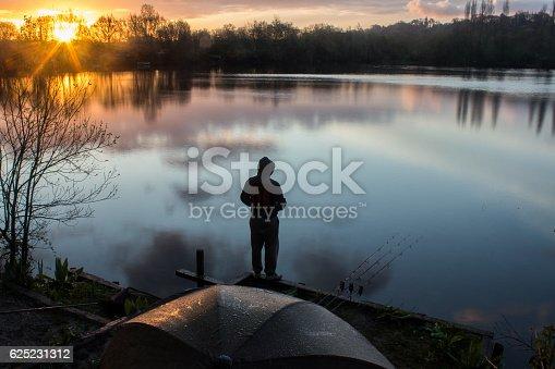 istock Sunrise Carp Angler overlooking Lake 625231312