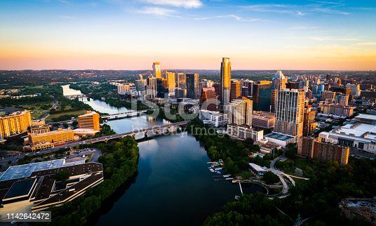 Aerial Drone view above the fastest growing city in America - Austin , Texas - The Capital City skyline under perfect colorful morning sunrise lighting - Sunrise Cityscape Skyline Austin Texas at Golden Hour Above Tranquil Lady Bird Lake 2019