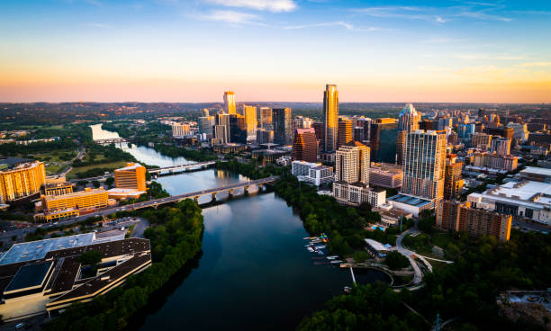 Sunrise Cityscape Skyline Austin Texas at Golden Hour Above Tranquil Lady Bird Lake 2019 Aerial Drone view above the fastest growing city in America - Austin , Texas - The Capital City skyline under perfect colorful morning sunrise lighting - Sunrise Cityscape Skyline Austin Texas at Golden Hour Above Tranquil Lady Bird Lake 2019 colorado river stock pictures, royalty-free photos & images
