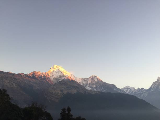 Sunrise colors the Annapurna Mountains stock photo