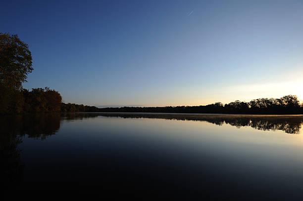Sunrise cross the lake stock photo