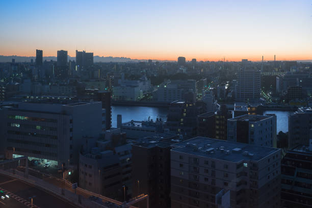 Sunrise dawn landscape epic scenery of downtown Tokyo buildings through the Sumida river. stock photo